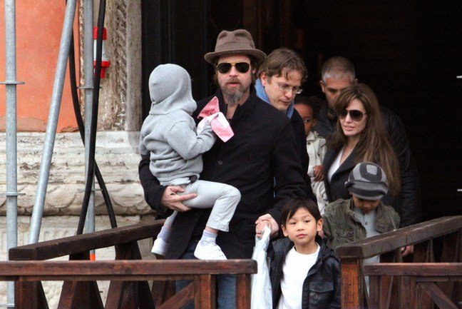 Brad Pitt hat black jacket Angelina Jolie sunglasses long coat