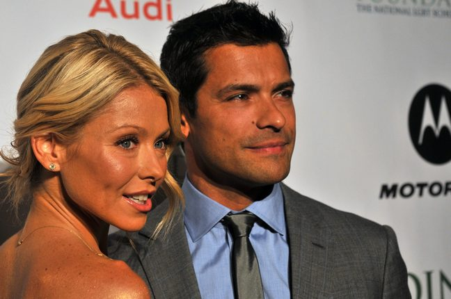 Kelly Ripa Mark Consuelos suit tie necklace earrings upswept hair