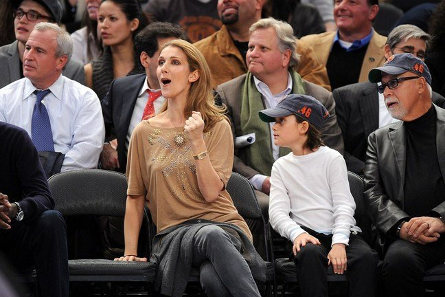 Celine Dion, gray denim jeans, beige blouse, gold watch