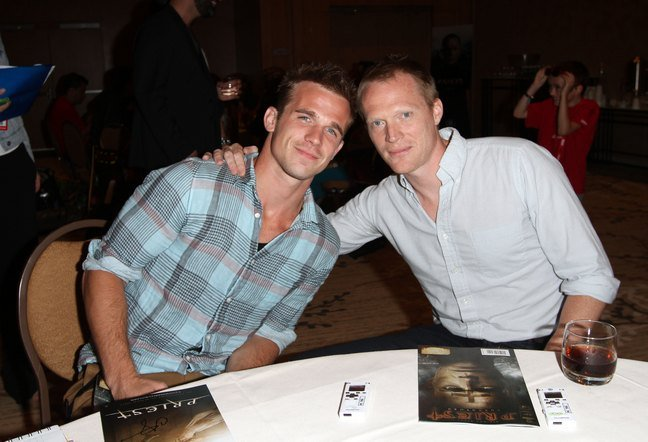 Cam Gigandet, green plaid shirt, tan pants, Paul Bettany, white shirt, black pants