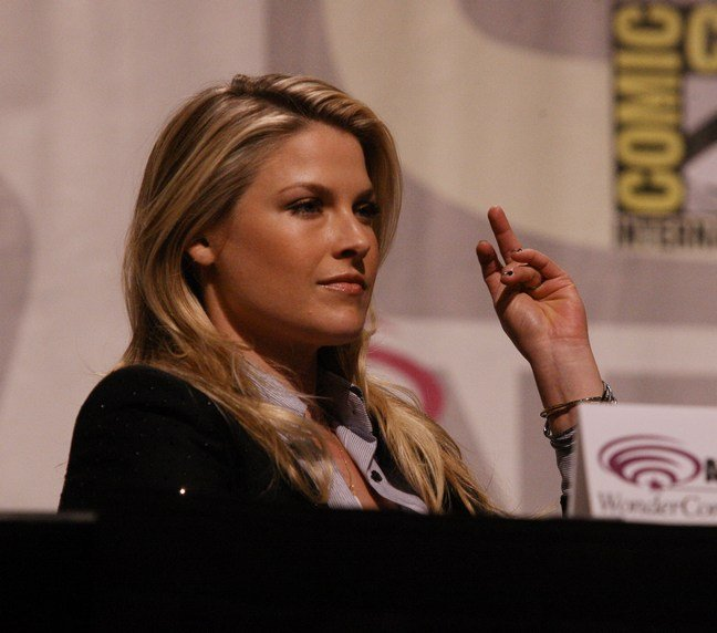 Ali Larter, Black jacket, grey button shirt, bracelets
