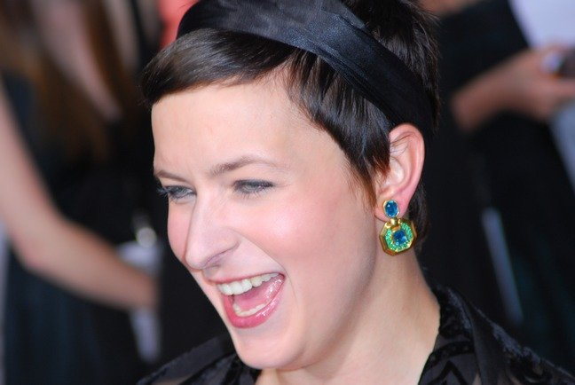 Diablo Cody, black silk headband, green and blue earrings, black top