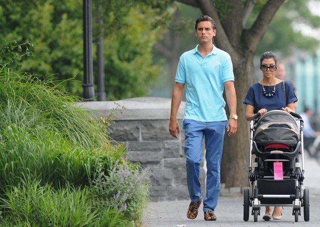 Kourtney Kardashian, sunglasses, navy blue blouse, necklace, bracelet, Scott Disick, aqua shirt, blue pants, leopard shoes
