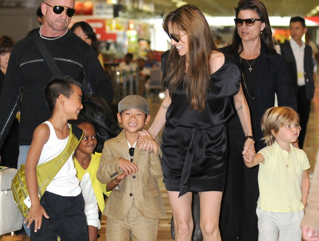 Angelina Jolie, flip flops, sunglasses, black silk minidress