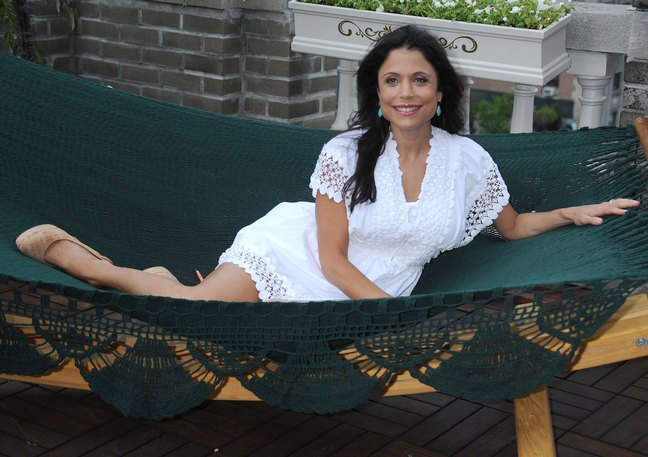 Bethenney Frankel, white lace dress, hammock, beige high heels, turquoise earrings