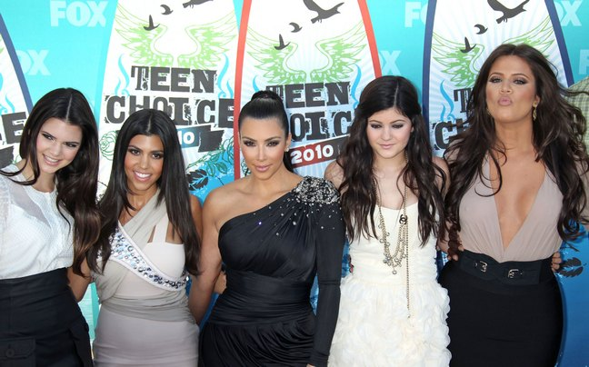Kourtney Kardashian, gray dress, Kim Kardashian black dress, Khloe Kardashian, tan dress, black skirt