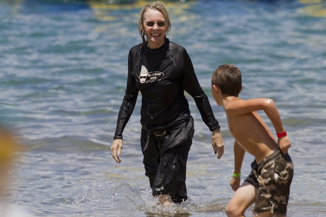 Diane Keaton, wetsuit, black shorts, black top, beach