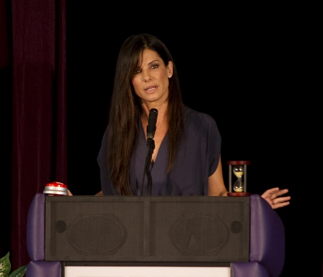 Sandra Bullock, navy dress, necklace, podium