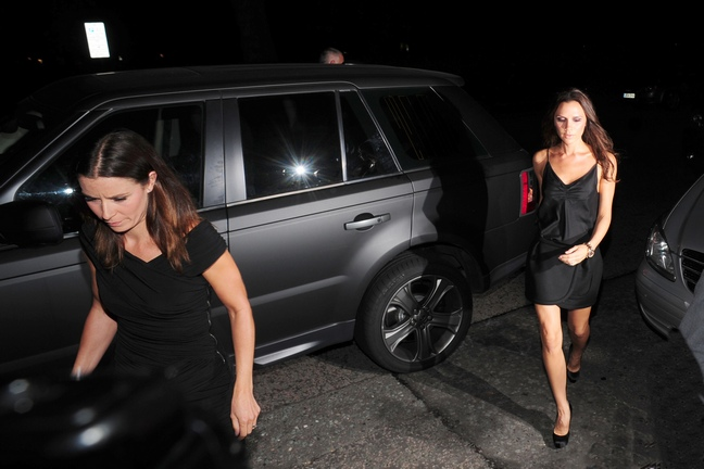 Victoria Beckham, black mini dress, black heels, clutch