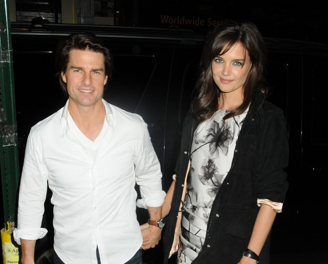 Katie Holmes, white dress, black floral print white dress, black sweater jacket, black jacket, Tom Cruise, white shirt, watch