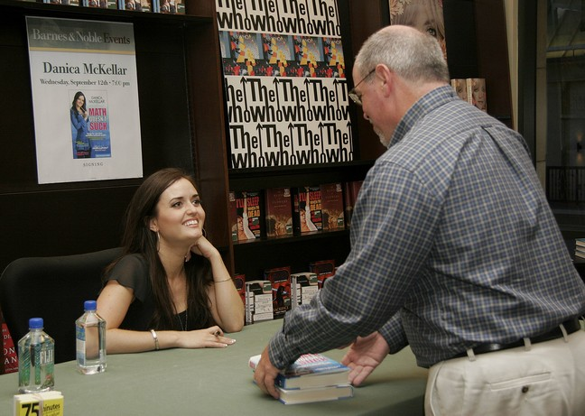 Danica McKellar, black top, black blouse, bracelet, watch, earrings, book signing