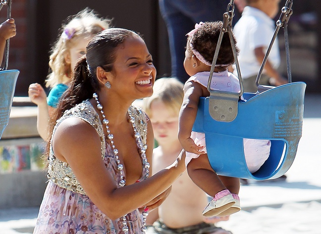 Christina Milian, sun dress, floral dress, silver beaded necklace, ponytail, park, swings