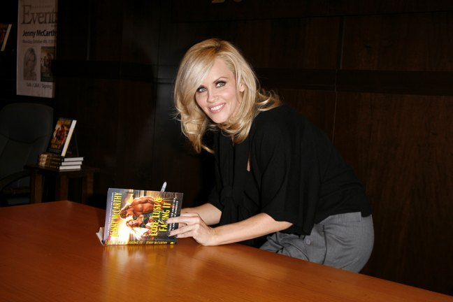 Jenny McCarthy, gray pants, black top, black blouse, book signing