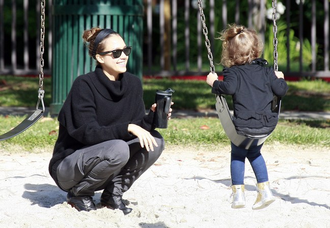 Jessica Alba wearing gray pants and a black sweater with a black headband, Jessica alba plays at park with honor marie