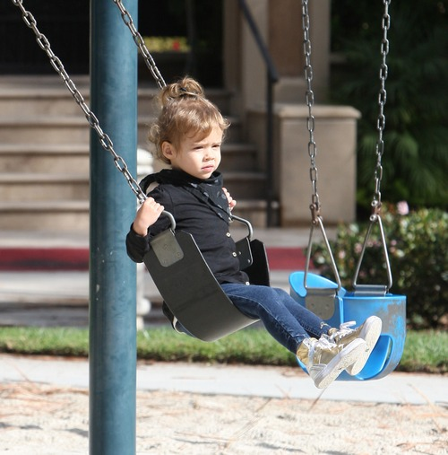 Jessica Alba's daughter Honour Marie swings at the park