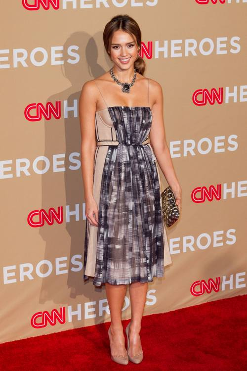 Jessica Alba attends the CNN Heroes event in a beige and gray dress