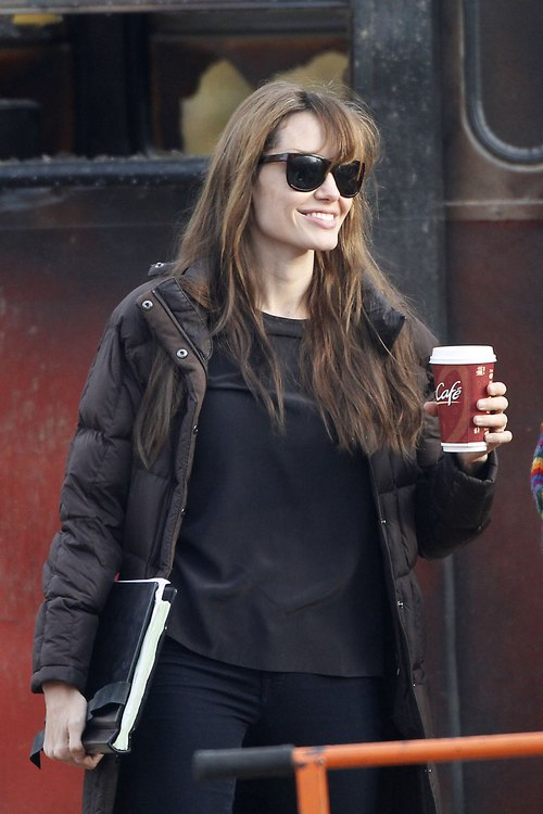 Angelina Jolie, sunglasses, coffee, black shirt, black leggings, black coat