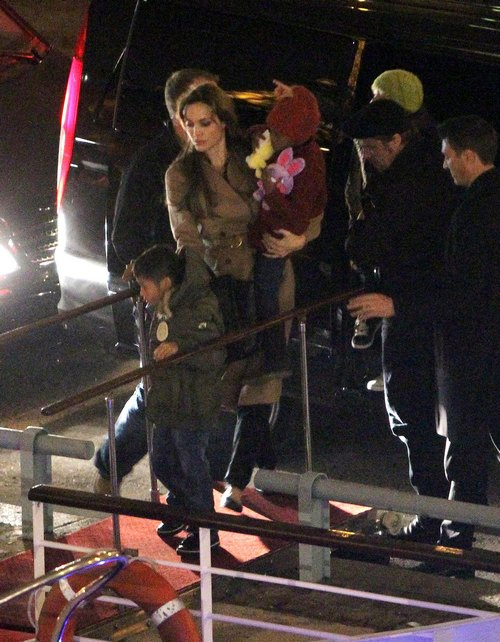Angelina Jolie and family in Paris for Pax's birthday wearing winter gear, tan coat, hat