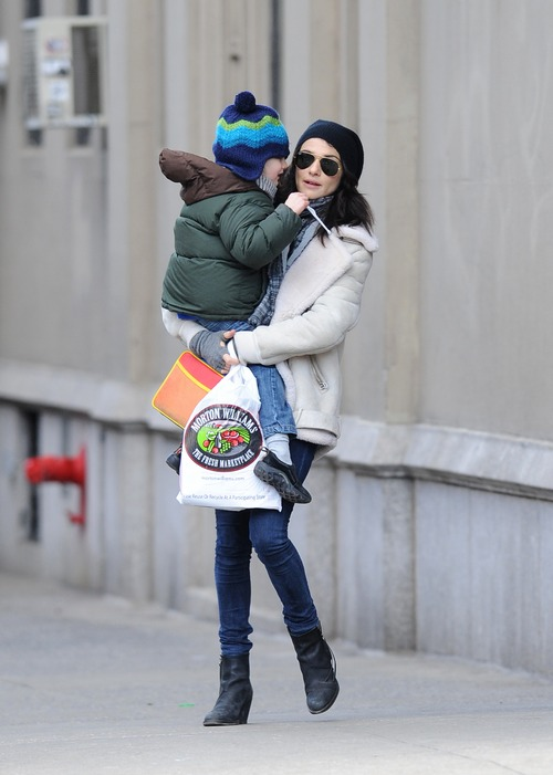 Rachel Weisz winter coat, whit jacket, black boots, jeans, knit black hat