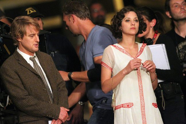 Marion Cotillard and Owen Wilson on set of Midnight in Paris
