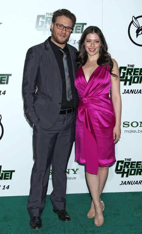 Seth Rogen in gray suit, Lauren Miller pink silk dress