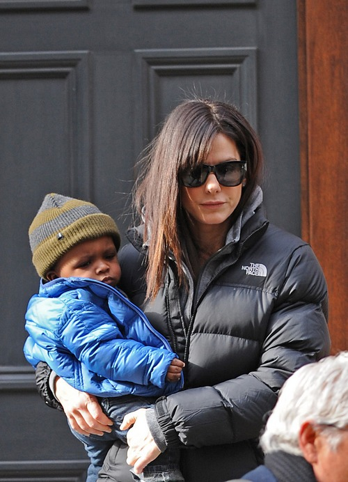 Sandra Bullock, black winter coat, sunglasses