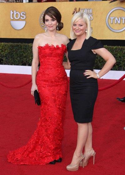 Tina Fey red strapless gown, Amy Poehler black dress