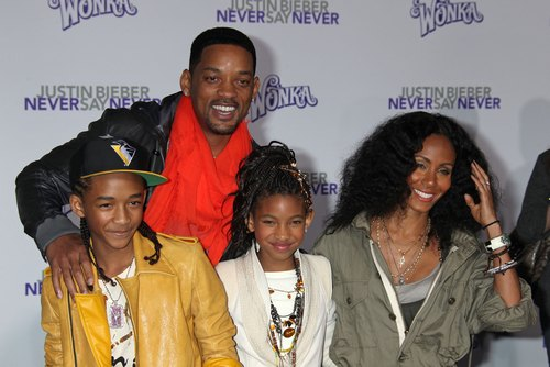 Will Smith red scarf, Jada Pinkett Smith green jacket
