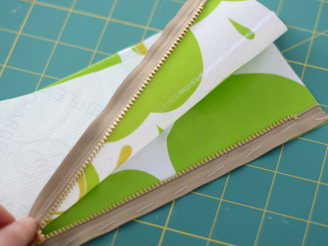 green apple fabric with gold zipper