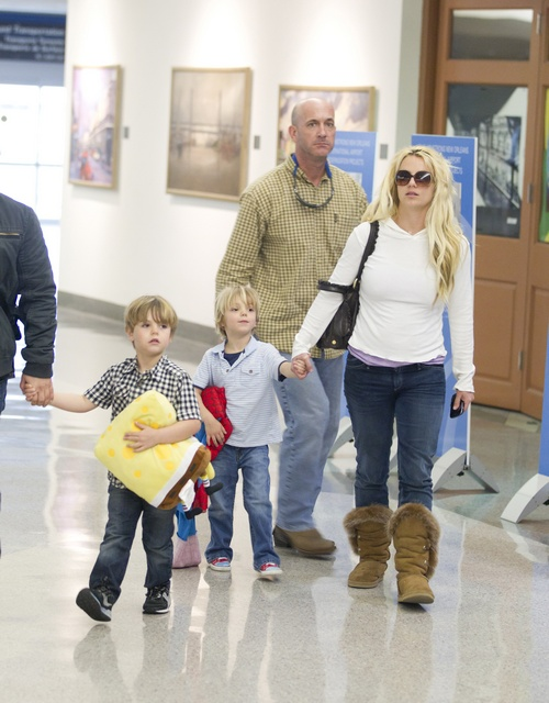 Britney Spears, white top, boots, jeans