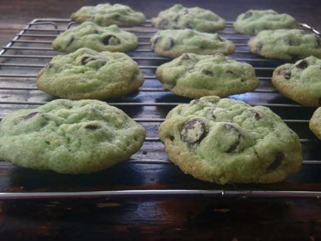 Green St Patricks Day cookies cooling on a wire rack