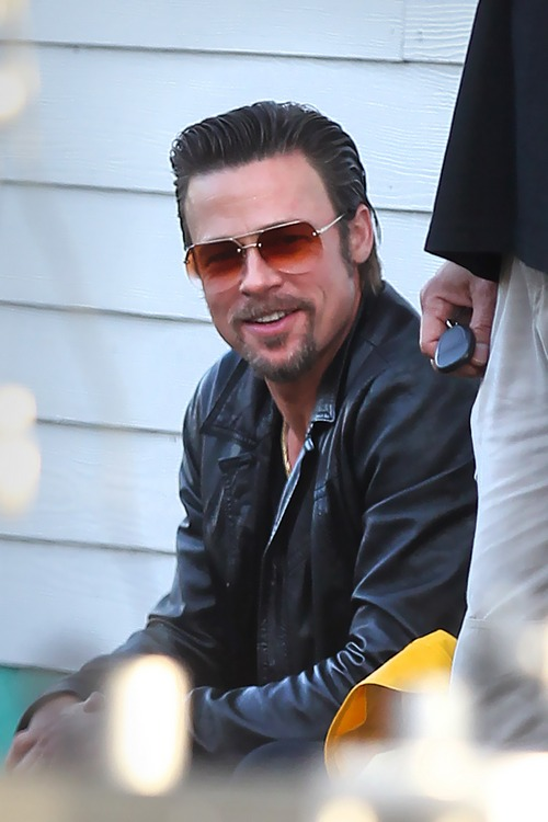 Brad Pitt, black leather jacket, sunglasses, movie set