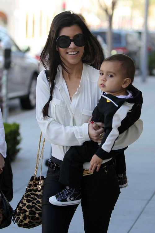 Kourtney Kardashian, sunglasses, white blouse, jeans, animal print purse