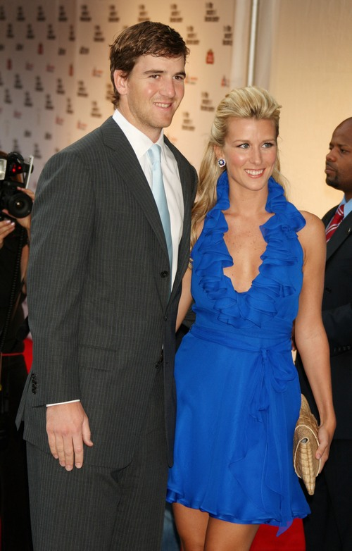 eli manning, dark suit, abby manning blue dress