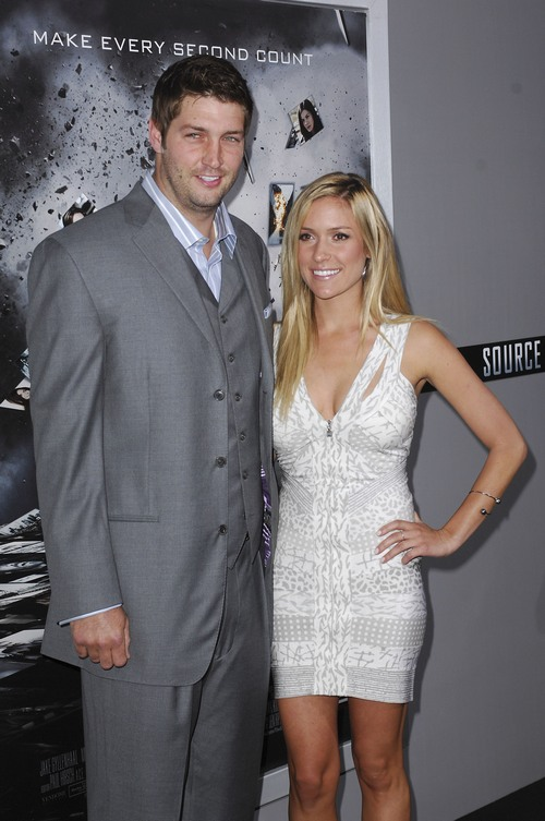 Kristin Cavallari white dress, Jay Cutler gray suit
