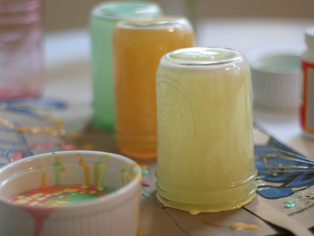 mason jars coated with a opaque mint green, orange and yellow substance on the inside