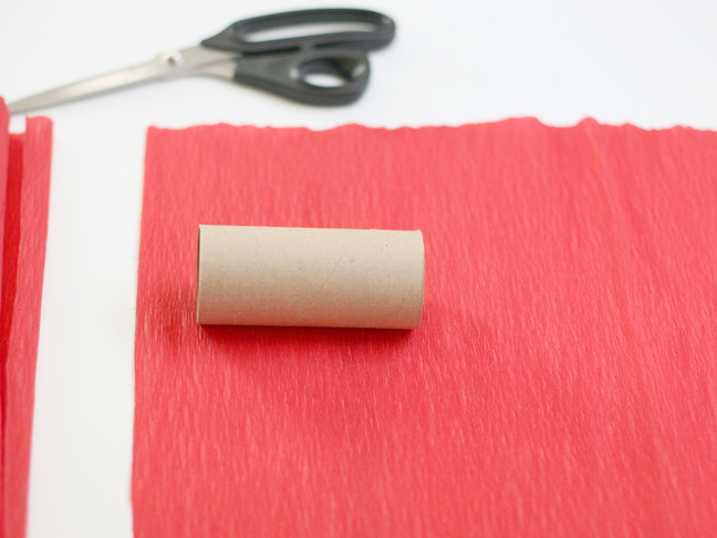 cut a piece of crepe paper three times the length of your roll