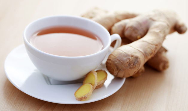 Detox Immunity Tea Recipe pictured in a white porcelain cup with fresh ginger