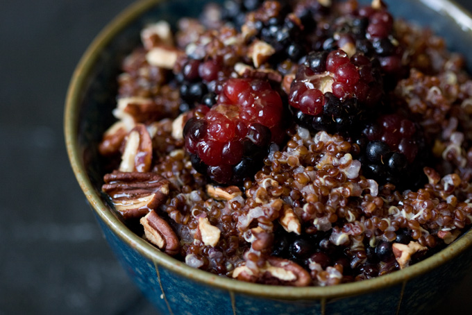Nutty, Cinnamon Bery Quinoa Recipe in a green bowl