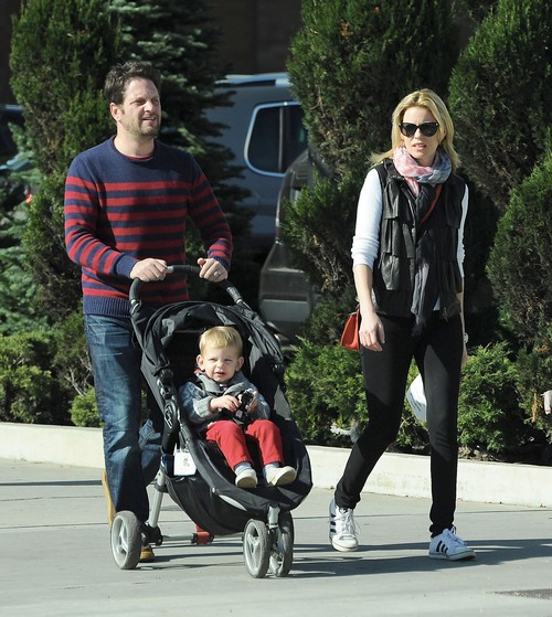 Banks and her husband take a stroll with their oldest child felix