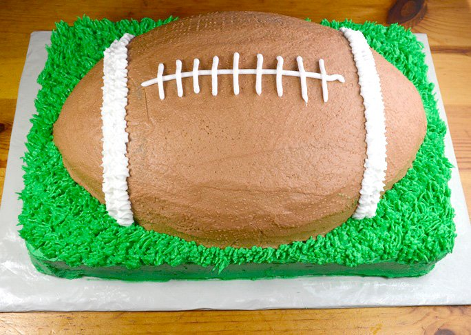 completed football shaped cake
