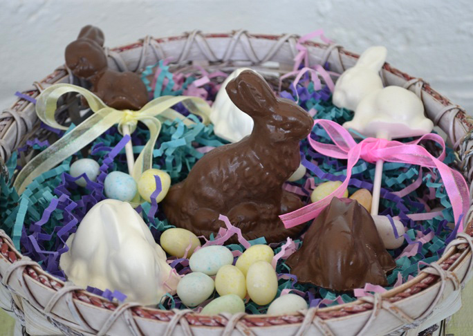 milk and white chocolate easter bunnies in a woven basket