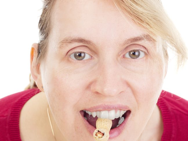 Woman eating peanut