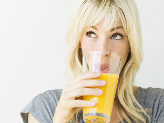blonde-woman-drinking-orange-juice
