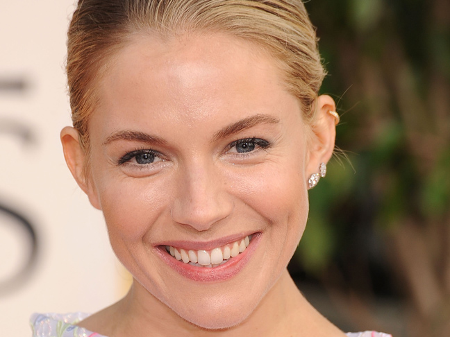 Sienna Miller with natural makeup and hair swept back