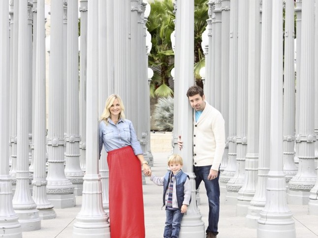 Mother and father with young son posing at the LACMA museum in Los Angeles