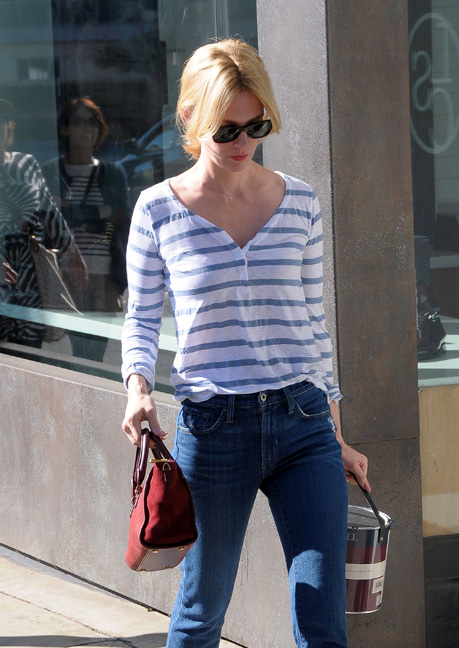 January Jones pictured in a striped henley with a red statement bag