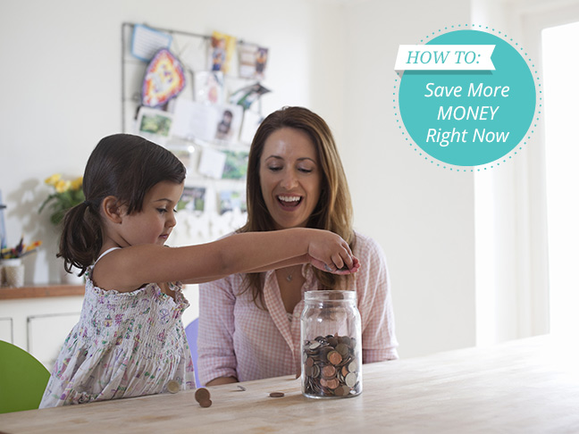 mother-daughter-filling-pink-piggy-bank-kitchen