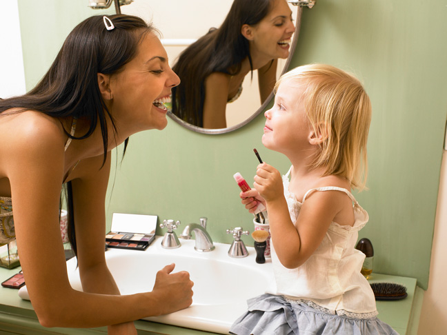 mom-putting-on-makeup-with-daughter