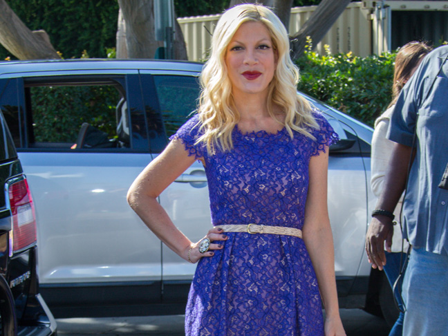 Tori Spelling in a blue lace belted dress